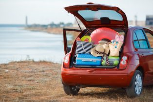 bigstock-Suitcases-and-bags-in-trunk-of-101954126-800x534